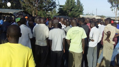A crowd at Kamukunji grounds, listening to their leaders on the political situation in Kibera