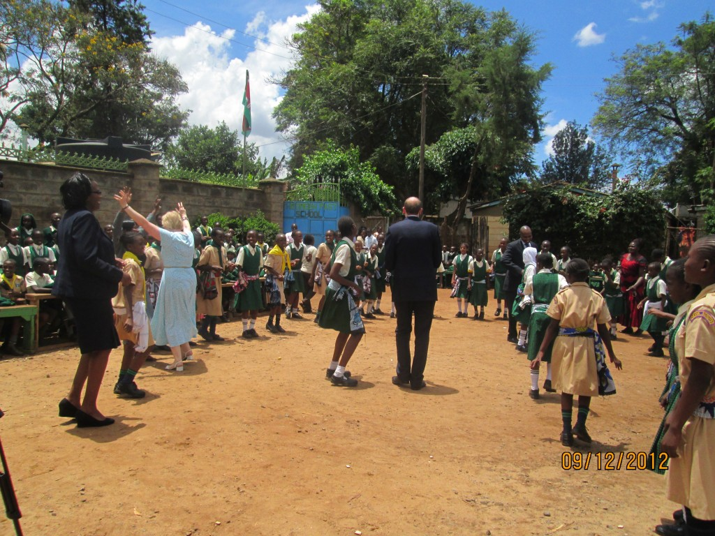 Guests join children in a dance