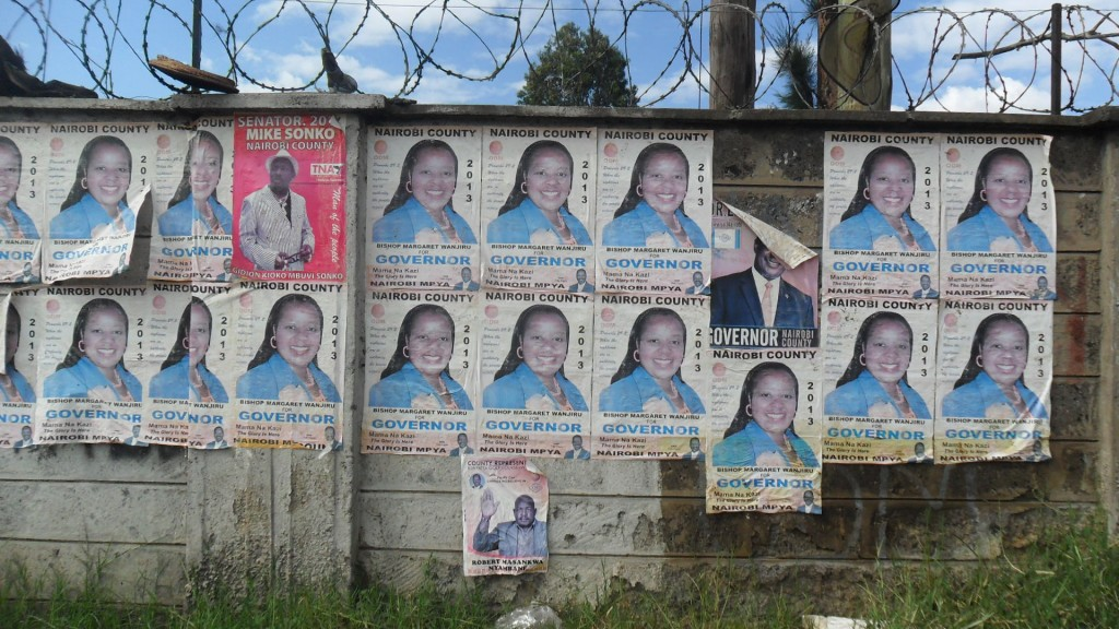 The state of the identified wall. It was dirty full of political aspirants' posters. The first duty was to clean it up.