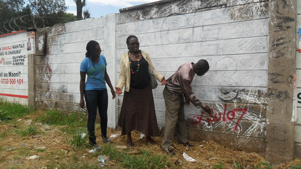 Millicent, Diana and Douglas clearing the identified wall